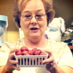 Millie Goforth shows an example of some of the produce from her garden she will be selling at the Bruce Farmers' Market.