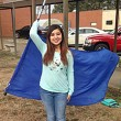 Marbella Vargas practices her flag-twirling skills before BHS Color Guard tryouts.